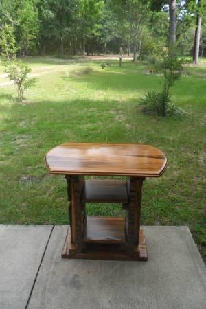 ONE OF A KIND HANDCRAFTED CARVED TABLE W/TWO SHELVES -