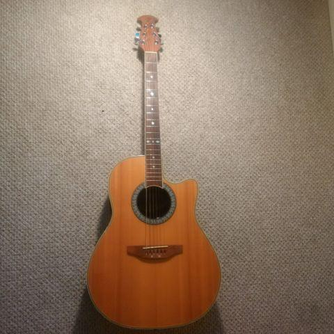 Ovation Acoustic/Electric Guitar - This thing can