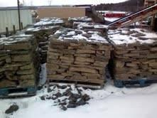 PALLETS OF STONE (PORT CRANE )