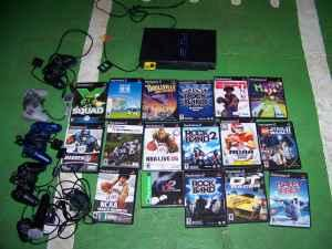 Playstation 2 with 15 Games, 4 Controllers - $75 (East