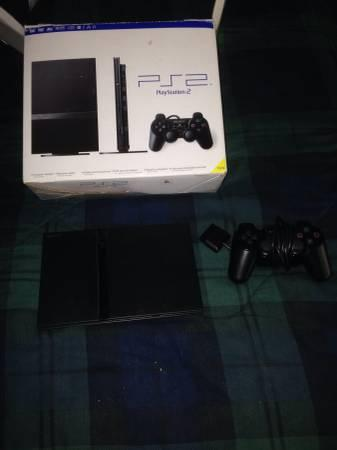 Playstation 2 with games - $75