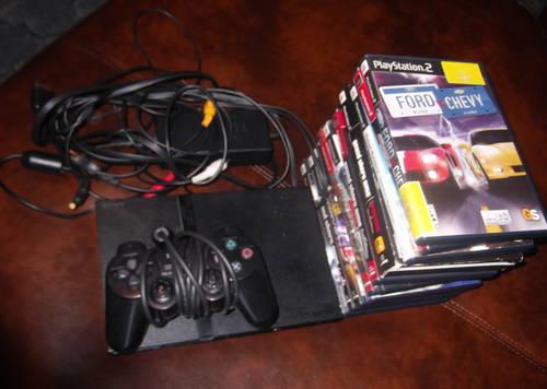 PlayStation 2 With Remote and Games (Only used twice)
