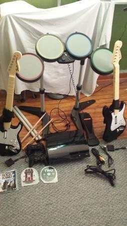 PlayStation 3 with two rock band guitars drums and more