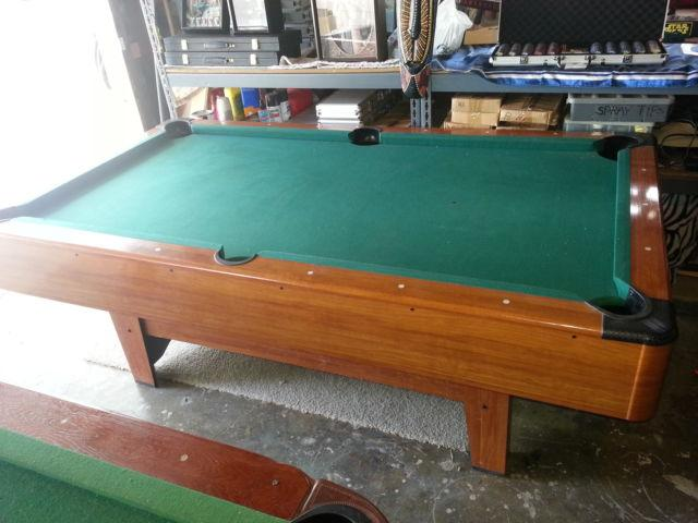 Pool table, wood , 7 foot long, leather pockets corners