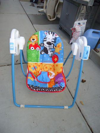 portable baby swing - $35 Missoula
