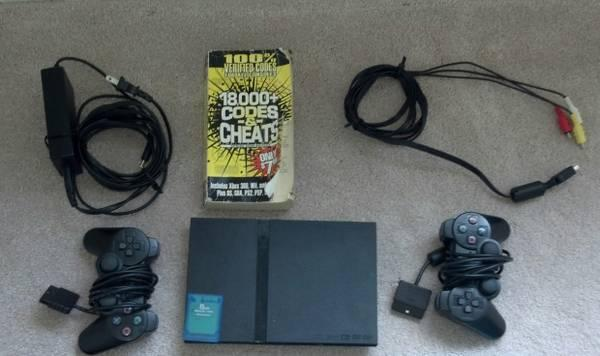 ps2 slim with/2 controllers/11 games/and more *price drop* - $90