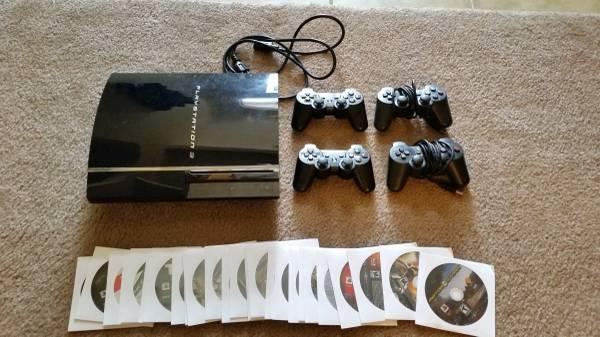 PS3 with 26 games and 4 controllers - $250