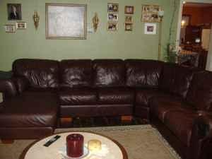 Raymour And Flannigan Wrap Around Dark Brown Leather Sofa