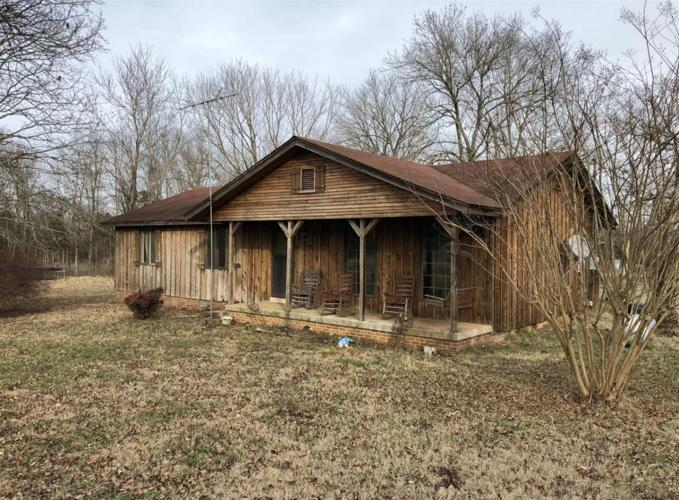 Real find here is the beautiful 16 acres and barns with