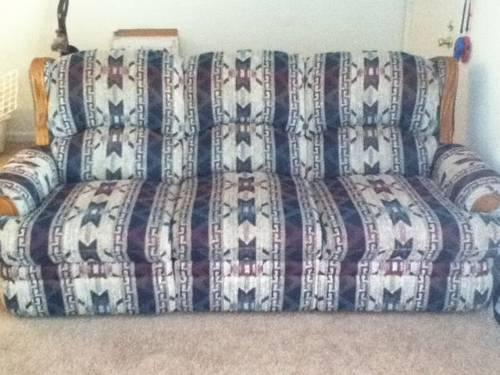 Reclining Berkline couch and love seat -used