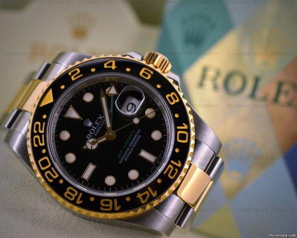 Rolex GMT Master II SS  18K Yellow Gold Black Dial