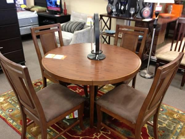 Round dining table and chairs for sale in riverton