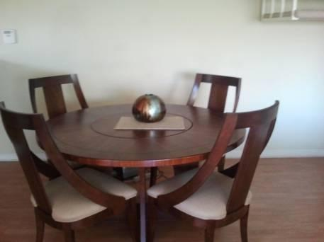Round Glass Top Dining Room Table and 4 Leather Chairs