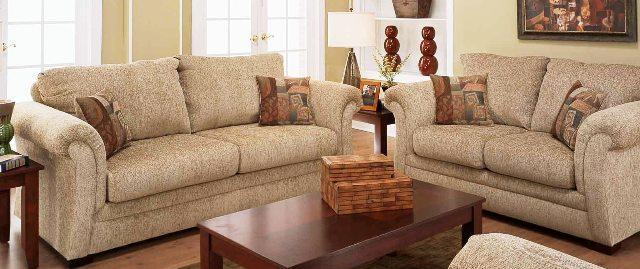 Sand colored sofa and loveseat with decorator pillows for Furniture 90 days same as cash