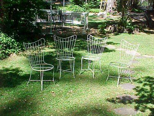 Set of 4 Shabby Vintage white wrought iron chairs.