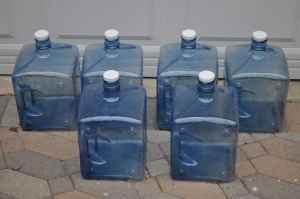 Six - 3 Gallon Refillable Water Bottles - Stackable -