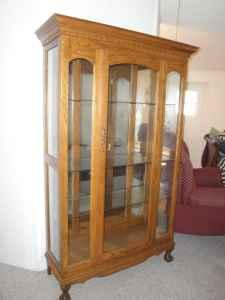 Solid Oak Curio Cabinet   $200 (Gulf Breeze)