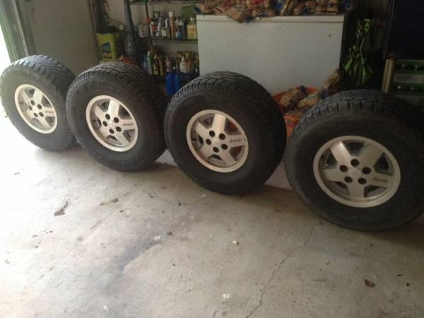 Stock jeep wheels and tires - $300