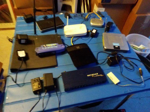 Table full of Router, WiFi units, Hubs, Switches, and