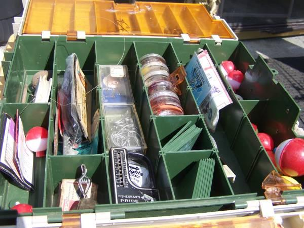 tackle box full of fishing supplys - $25