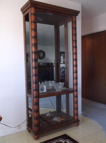 Tall china cabinet with glass shelves