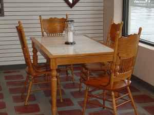 TILE TOP OAK TABLE WITH FOUR SCROLLED OAK CHAIRS