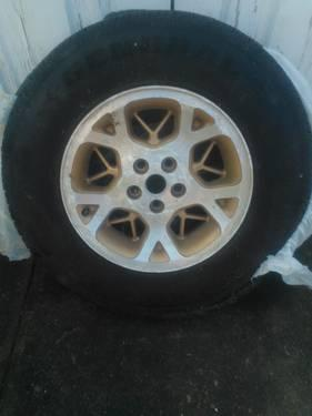 TIRE AND RIM, LIKE NEW