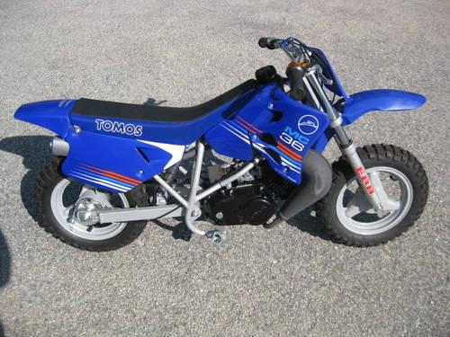 Tomos mini dirt bike for kids new in crate below wholesale for sale in