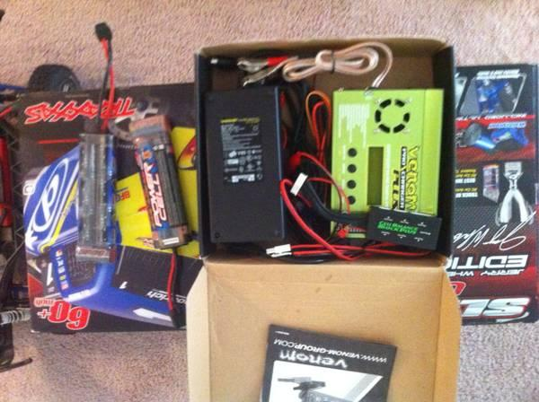 Traxxas Slash 4x4 and Venom pro plus charger system - $300