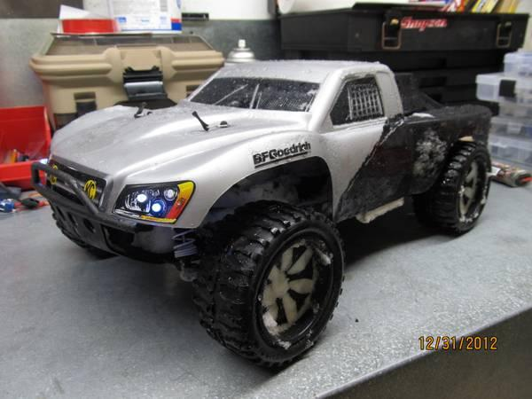 Traxxas Slash 4x4 wupgreades $ lots of extra parts - $550