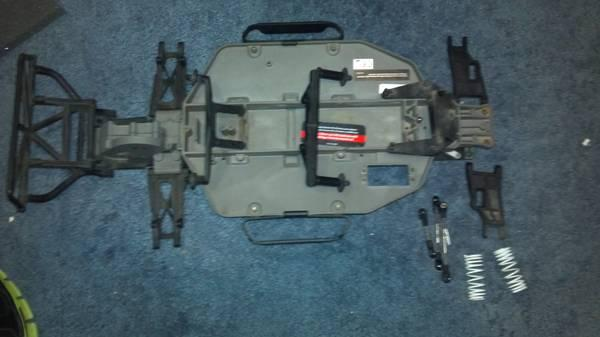 TRAXXAS SLASH CHASSIS PARTS trade - $30