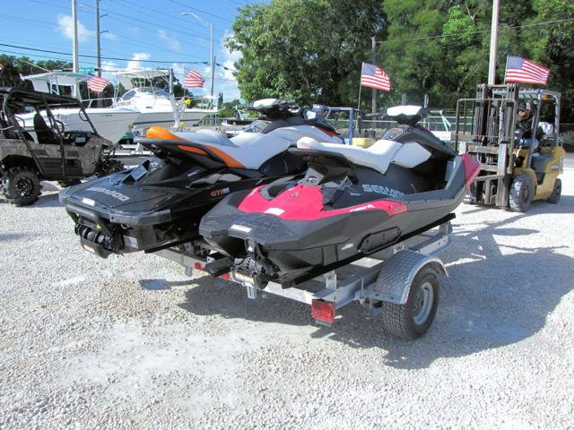 Two 2014 Sea Doo Jet Skis and Trailer Package by Boat