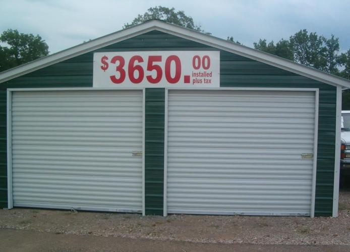 Two car garage installed barns carports tennessee for Rv with car garage for sale