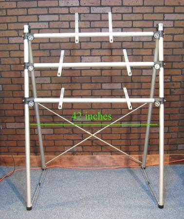 Two Ultimate Support 3 Tier A Frame Keyboard Stands For