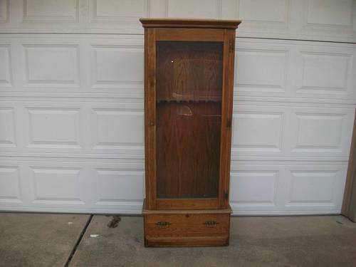 Used Oak gun Cabinet