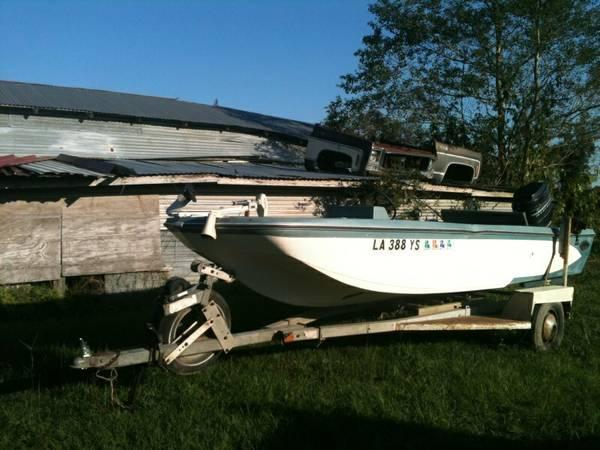 Vintage boat, motor and trailer