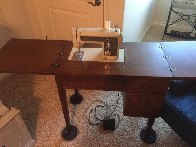 vintage kenmore sewing machine in cabinet