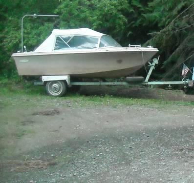Vintagge 14 Foot boat and outboard motor on trailer -