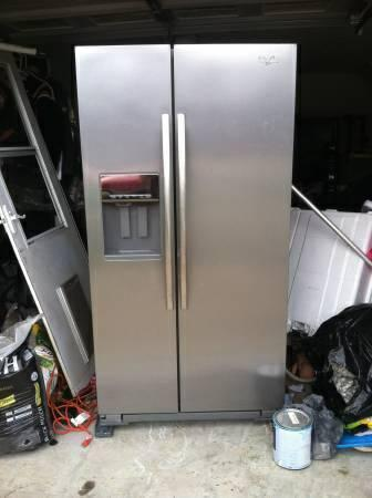 Whirlpool stainless steel refrigerator side by side. - $800