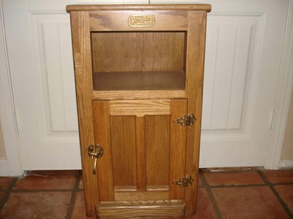 White Clad Oak Cabinet   $125