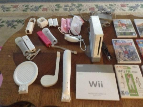 Wii Console with 8 games & lots of accessories - $200