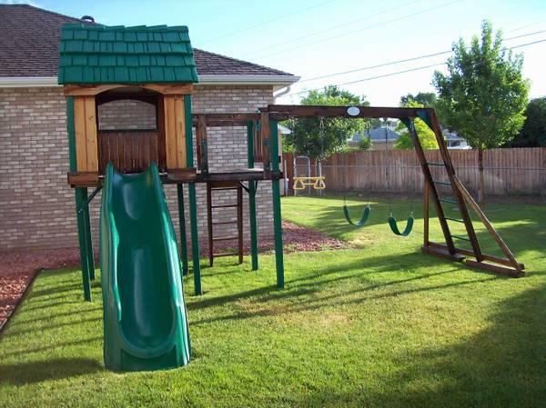 Wooden Clubhouse With Swing Set Slide And Climb Wall