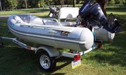 """Please call owner Ron at 410-920-3131. Located in Coatesville, Pennsylvania. Inflatable Boat - Zodiac 10'8"""" RIB Fiberglass V-Bottom. Purchased new from dealer in August, 2012 - original owner. Tohatsu"""