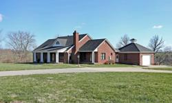 Small horse farm located just outside Paris! This 10 year old custom build all brick ranch is situated on 23.599 acres of gently rolling land with total privacy. 2608 square feet on the first level fe