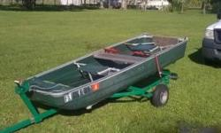 12 foot coleman boat , very light weight, with trailer and title $500. o.b.o.