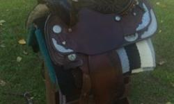 American Saddlery Western Show Saddle with matching breast collar and headstall. Lots of silver. Excellent Condition. Will also throw in a woven blanket. Pickup Only, will not ship.