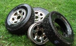 Three wheels and tires from a Nissan pathfinder...will fit a truck also, see pic for specs. Plenty of tread left.