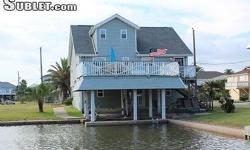 COMFORTABLE ... COMFORTABLE ... COMFORTABLE. Waterside Property in Jamaica Beach! Relax w your in this well selected home that sits on a wide canal right behind the bird && amp; fish sanctuary, less t