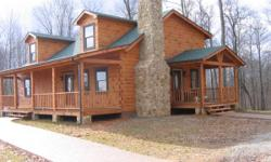 This is a beautiful log home with an adjoining 60 acre fenced area that can be used for your personal enjoyment.  If you want to hike, ride a bike or an atv this area is perfect.  The back part of thi