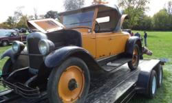 1927 Chevrolet Roadster ..Model AA Capitol ..All Original ..Yellow Paint ..Black Fenders ..Black Soft Top ..Yellow Dash Nice ..Black Leather Interior ..Car Has Trunk ..Rear Mounted Spare ..Asking $16,